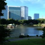 The traditional tea house on the pond at the Hamarikyu Gardens, over shadowed by the modern skyscrapers behind,