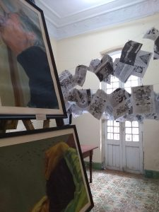 Exhibition at a back-garden arts festival. On the line are pamphlets published by a Cuban writing collective.
