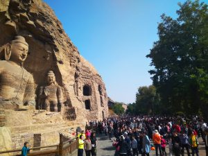 The fantastic Buddhist statues and the accompanying crowds